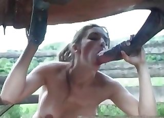 Big-breasted woman swallows a dick of a pony